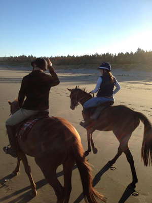 On the beach: enjoying a ride with Rachael Alder.